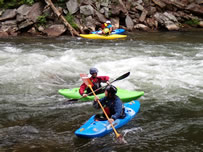 Kayaking in white water at Natahala Outdoor Center in Bryson City NC.